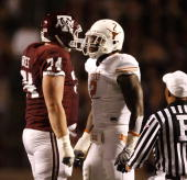 Right tackle Lee Grimes of the Texas AM Aggies confronts defensive end Sergio Kindle of the Texas Longhorns in the first half at Kyle Field on...