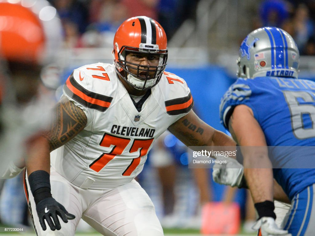 Right tackle Zach Banner #77 of the Cleveland Browns prepares to engage defensive end Anthony Zettel #69 of the Detroit Lions in the third quarter of a game on November 12, 2017 at Ford Field in Detroit, Michigan. Detroit won 38-24.