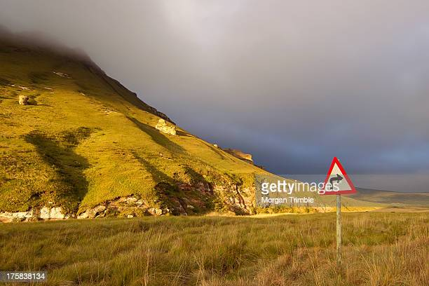 Right turn road sign in front of dramatic mountain scenery in Golden Gate Highlands National Park, Free State Province, South Africa