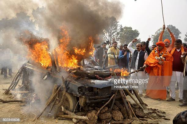 Right wing activist Chakrapani Maharaj and his followers burn down an old car belonging to underworld don Dawood Ibrahim on December 23 2015 in...