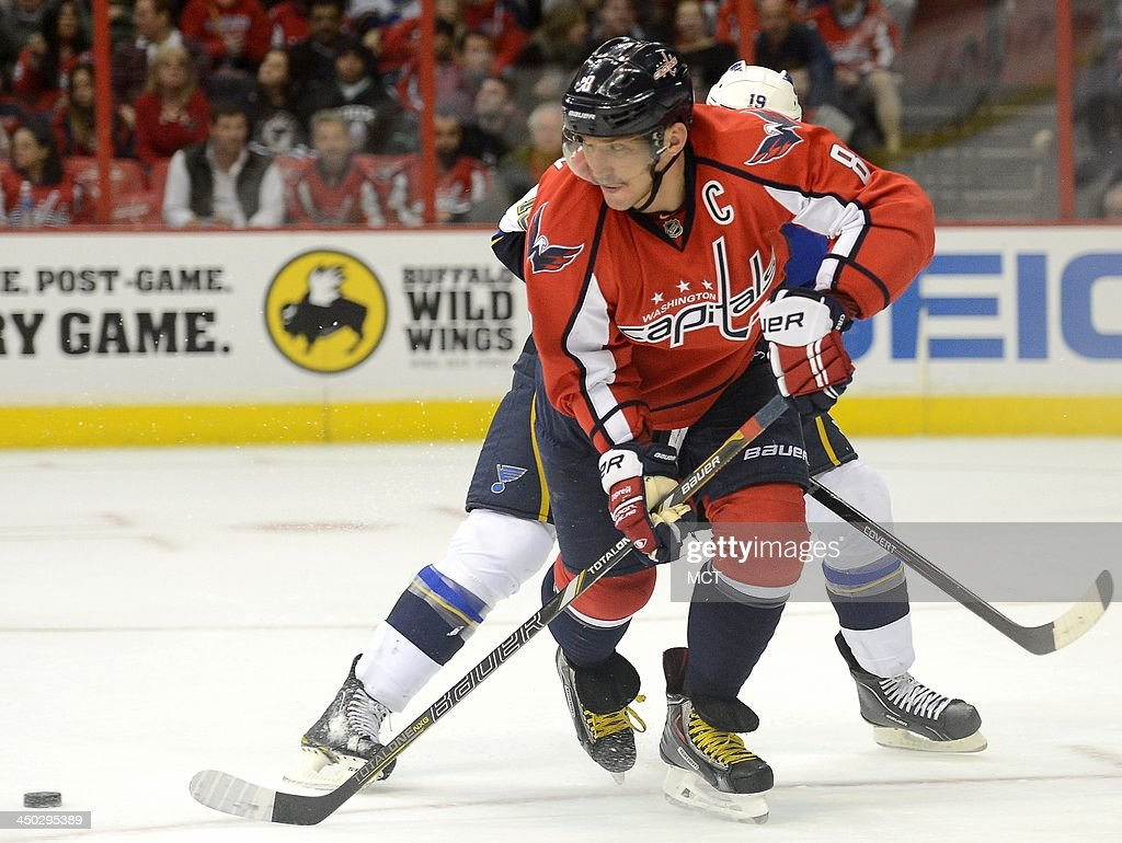 Right wing Alex Ovechkin (8) of the Washington Capitals lays off a pass behind him, as defenseman Jay Bouwmeester (19) of the St. Louis Blues defends, in the second period at the Verizon Center in Washington, Sunday, Nov, 17, 2013. The Capitals defeated the Blues, 4-1.