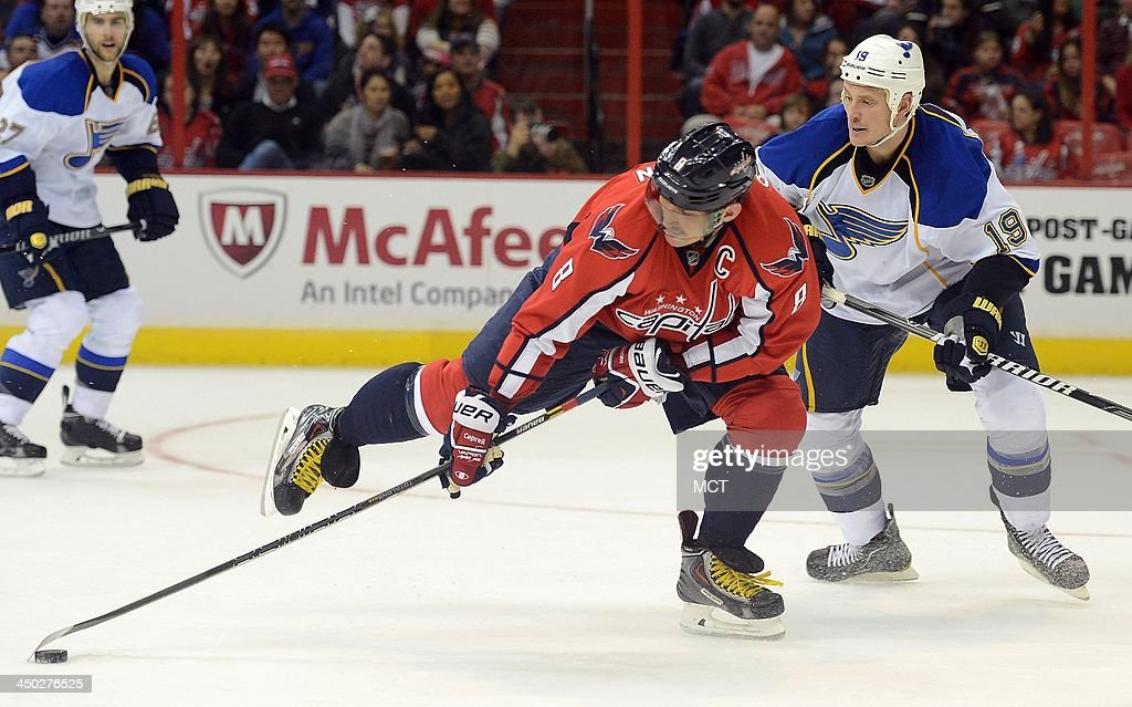 Right wing Alex Ovechkin (8) of the Washington Capitals stretches in an attempt to maintain control of the puck against St. Louis Blues defenseman Jay Bouwmeester (19) in the second period at the Verizon Center in Washington, Sunday, Nov, 17, 2013.