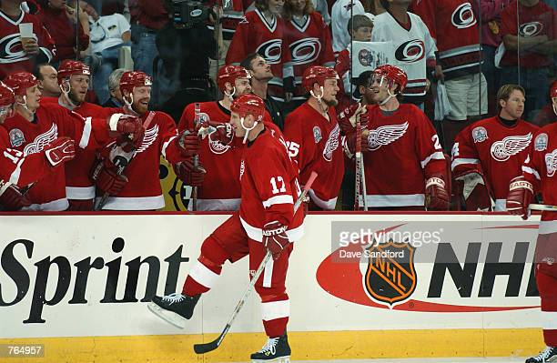Right wing Brett Hull of the Detroit Red Wings receives congratulations from the bench during game three of the NHL Stanley Cup Finals against the...