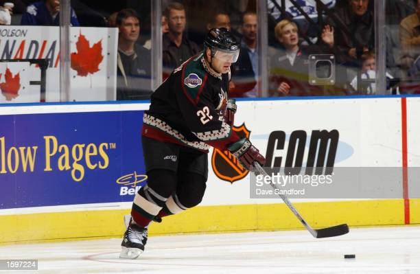 Right wing Claude Lemieux of the Phoenix Coyotes skates with the puck against the Toronto Maple Leafs during the NHL game on October 17 2002 at the...