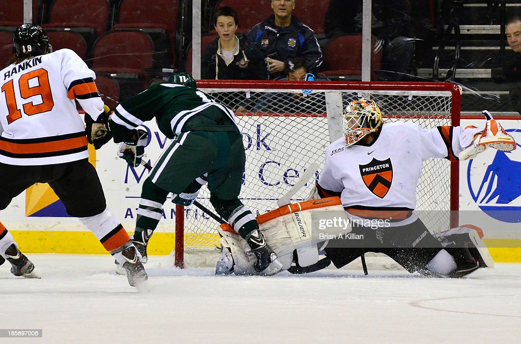 Right wing Eric Neiley #11 of the Dartmouth Big Green scores the game tying goal against goalie Sean Bonar #1 of the Princeton Tigers with less than a minute left in regulation at Prudential Center on October 25, 2013 in Newark, New Jersey. The Princeton Tigers won 3-2 in overtime.