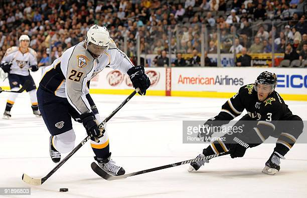 Right wing Joel Ward of the Nashville Predators skates the puck past Stephane Robidas of the Dallas Stars at American Airlines Center on October 14...