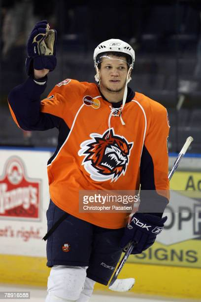 Right wing Kyle Okposo of the Bridgeport Sound Tigers salutes the crowd after being named the star of the game against the Springfield Falcons at...