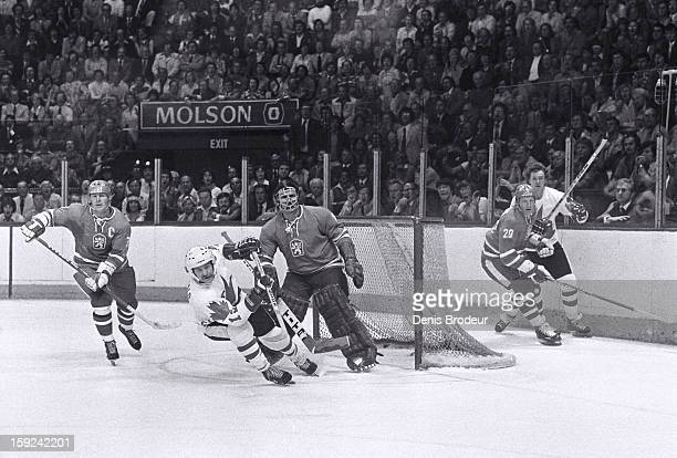 Right wing Lanny McDonald of team Canada skates in front of defenseman Frantisek Pospisil and goalie Vladimir Dzurilla of team Czechoslovakia during...
