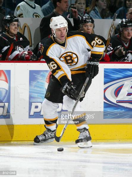 Right wing Mike Knuble of the Boston Bruins controls the puck during the game against the Buffalo Sabres at HSBC Arena on February 5 2005 in Buffalo...
