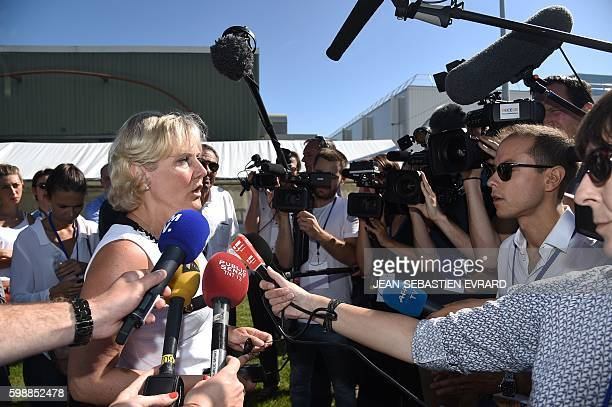 Right wing party 'Les Republicains' member Nadine Morano answers journalists' questions as she arrives for a LR political rally in La Baule on...