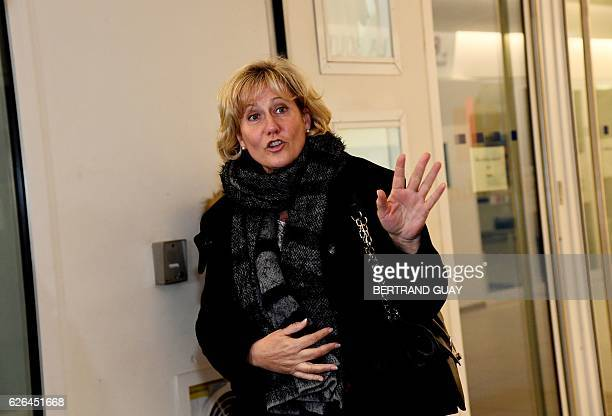 Right wing party 'Les Republicains' member Nadine Morano gestures as she leaves LR party's headquarters in Paris on November 29 2016 after a meeting...