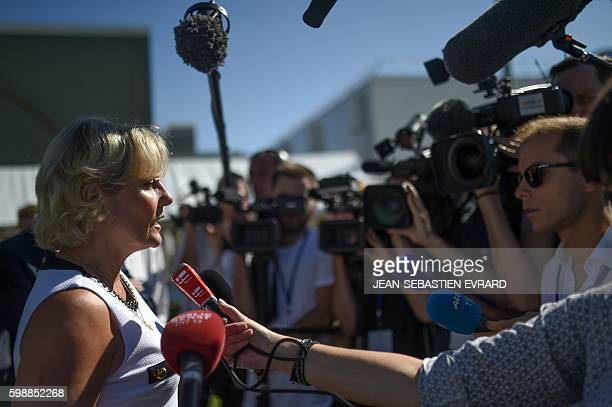 Right wing party 'Les Republicains' member Nadine Morano speaks to journalists as she arrives for a LR political rally in La Baule on September 3...
