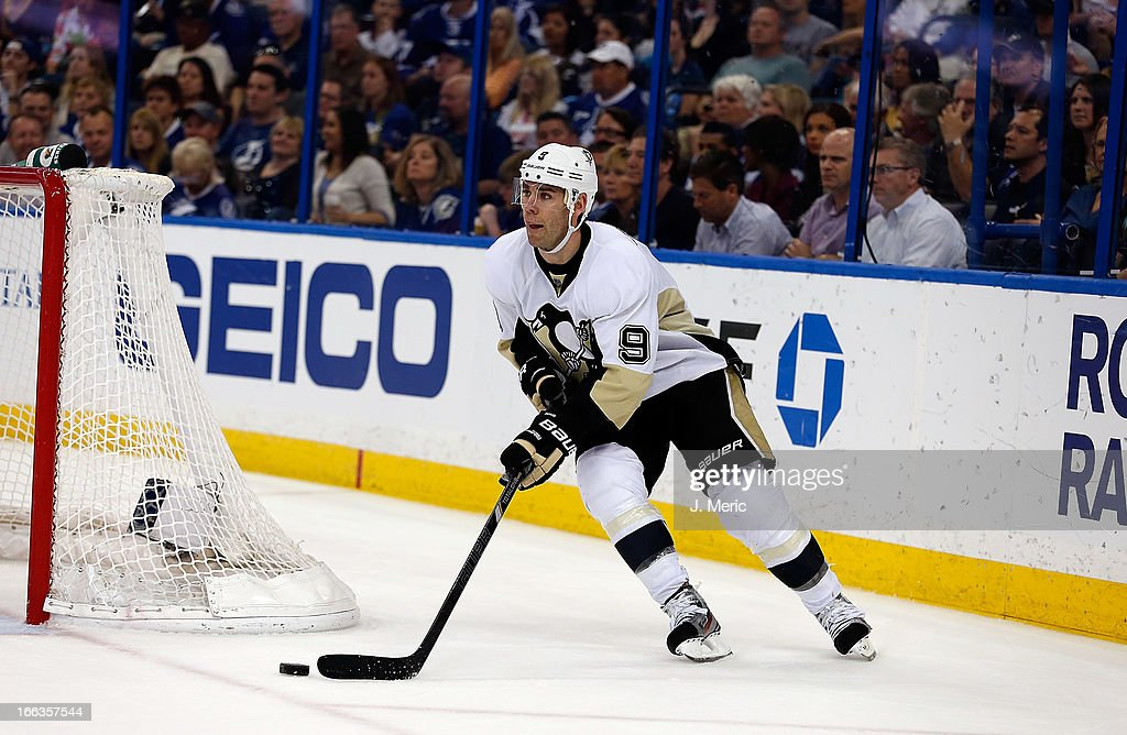 Right wing <a gi-track='captionPersonalityLinkClicked' href=/galleries/search?phrase=Pascal+Dupuis&family=editorial&specificpeople=208971 ng-click='$event.stopPropagation()'>Pascal Dupuis</a> #9 of the Pittsburgh Penguins advances the puck against the Tampa Bay Lightning during the game at the Tampa Bay Times Forum on April 11, 2013 in Tampa, Florida.