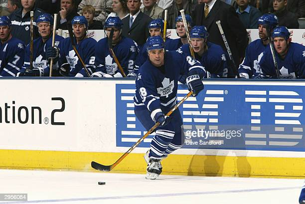 Right wing Tie Domi of the Toronto Maple Leafs controls the puck during the game against the Nashville Predators at Air Canada Center on January 6...