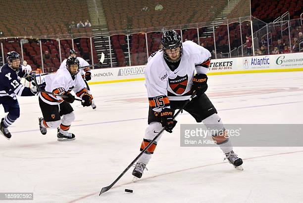 Right wing Tyler Maugeri of the Princeton Tigers prepares to shoot the puck against the Yale Bulldogs at Prudential Center on October 26 2013 in...