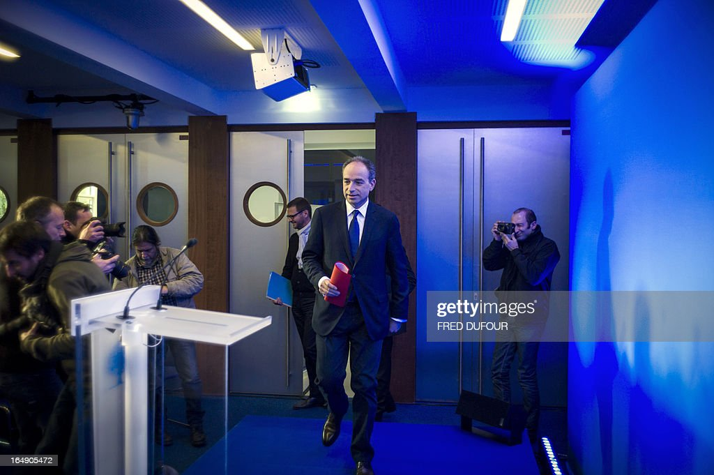 Right wing UMP opposition party president Jean-François Cope arrives for a press conference at the UMP headquarters, on March 29, 2013 in Paris. A day after the French President Francois Hollande's interview on the French national television channel, Cope considered during an interview on the radio RTL that 'everything is in place to ensure a deep breach between Francois Hollande and the Frenchmen'. AFP PHOTO / FRED DUFOUR