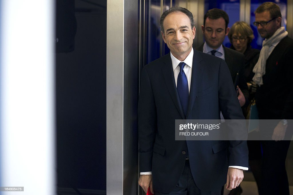 Right wing UMP opposition party president Jean-François Cope arrives for a press conference at the UMP headquarters, on March 29, 2013 in Paris. A day after the French President Francois Hollande's interview on the French national television channel, Cope considered during an interview on the radio RTL that 'everything is in place to ensure a deep breach between Francois Hollande and the Frenchmen'.