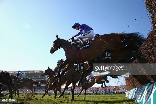 Rightdownthemiddle ridden by Jack Kennedy jumps a fence during the Betway Handicap Steeple Chase at Aintree Racecourse on April 8 2017 in Liverpool...