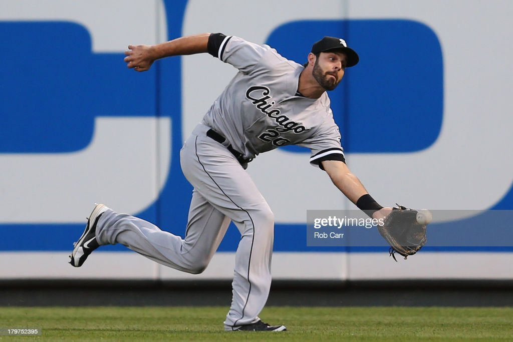 Rightfielder <a gi-track='captionPersonalityLinkClicked' href=/galleries/search?phrase=Jordan+Danks&family=editorial&specificpeople=2364706 ng-click='$event.stopPropagation()'>Jordan Danks</a> #20 of the Chicago White Sox catches a ball hit by Brian Roberts #1 of the Baltimore Orioles (not pictured) for the first out of the first inning at Oriole Park at Camden Yards on September 6, 2013 in Baltimore, Maryland.