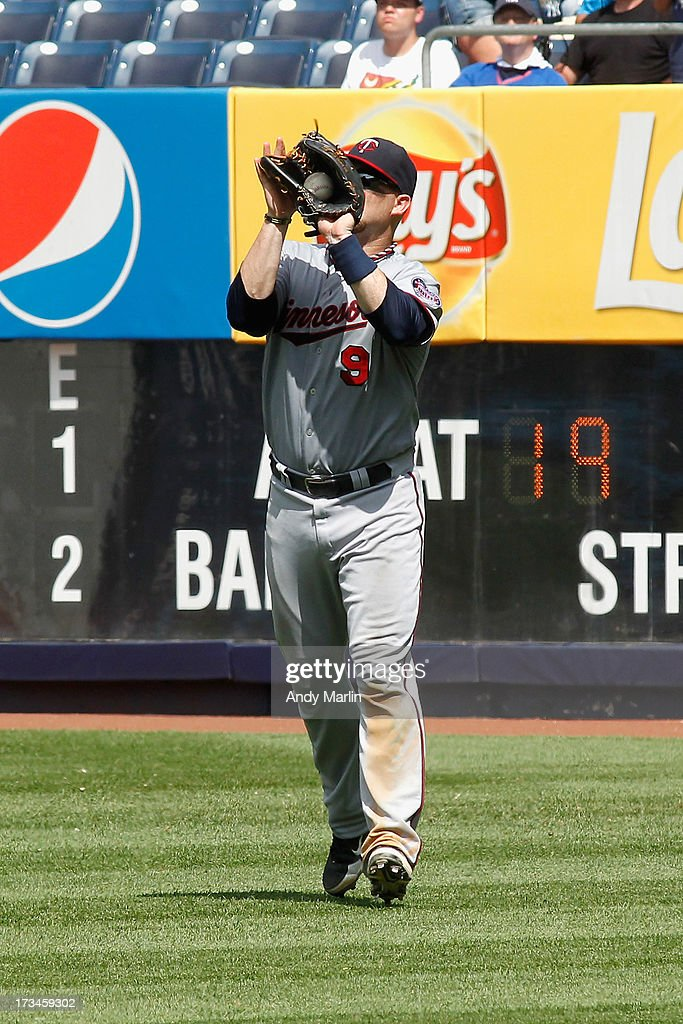Rightfielder <a gi-track='captionPersonalityLinkClicked' href=/galleries/search?phrase=Ryan+Doumit&family=editorial&specificpeople=598785 ng-click='$event.stopPropagation()'>Ryan Doumit</a> #9 of the Minnesota Twins makes the putout in the bottom of the sixth inning against the New York yankees at Yankee Stadium on July 14, 2013 in the Bronx borough of New York City.