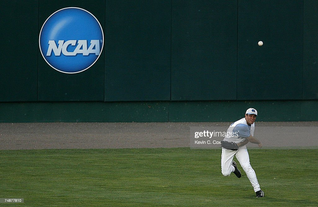 Rightfielder Tim Fedroff of the North Carolina Tar Heels tosses a ball in from the outfield during their 93 loss to the Oregon State Beavers in Game...