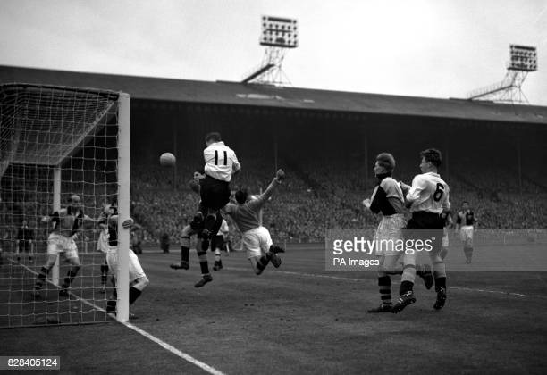 Righthalf Bobby Hardisty and other Bishop Aukland players cluster in the goalmouth in the hope of keeping the ball out but in fact it is on its way...