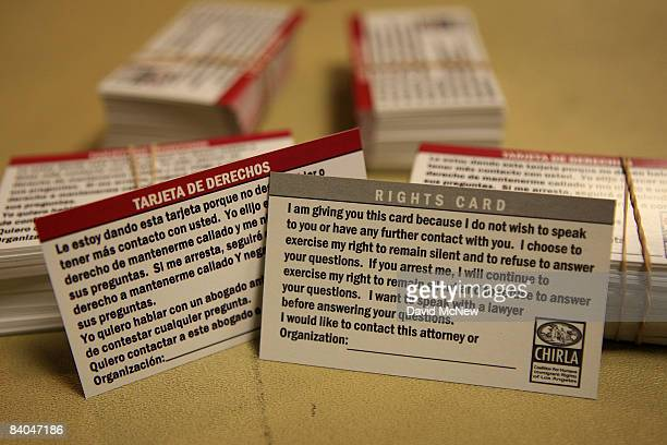 Rights Cards with messages written in both English and Spanish on opposite sides are given to immigrants to help them deal with challenging legal...