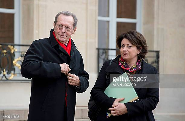 Rights defenders Dominique Baudis and Marie Derain pose for photographers as they leave the Elysee presidential Palace in Paris on January 6 after...