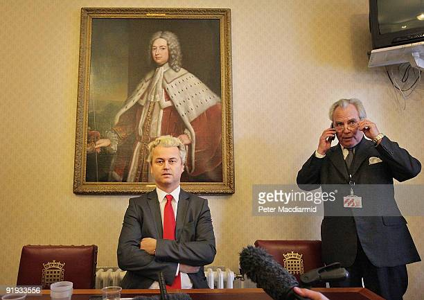 Rightwing Dutch MP Geert Wilders is watched by Lord Pearson as he speaks to reporters near Parliament on October 16 2009 in London Mr Wilders was...