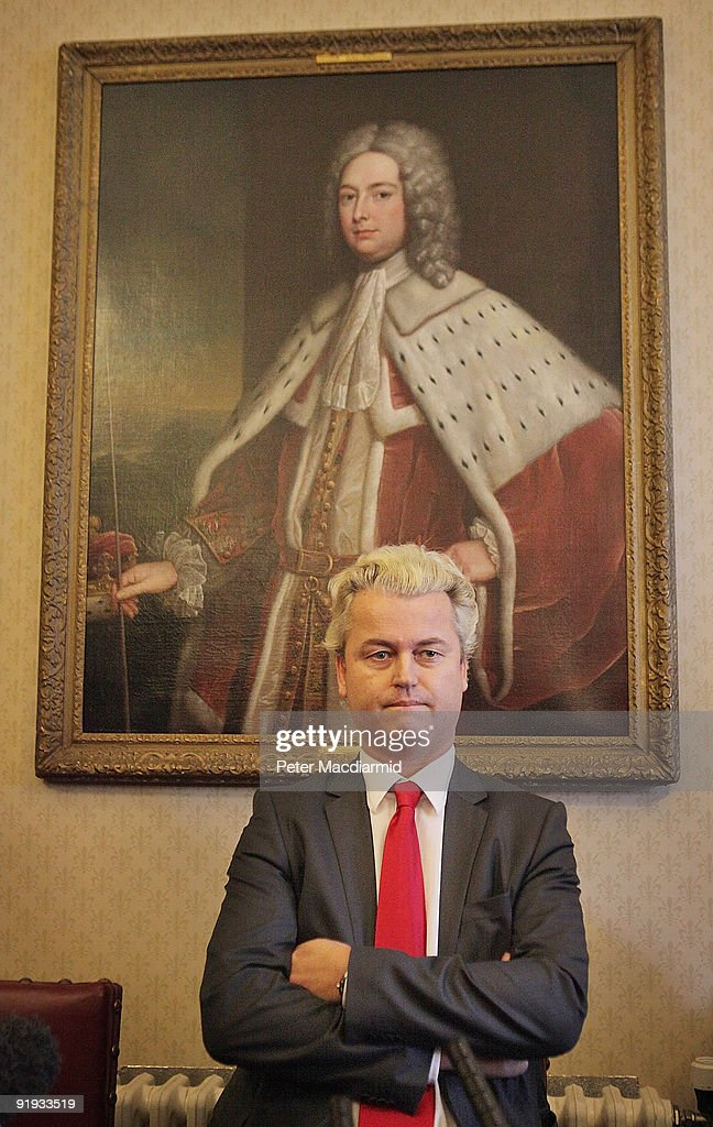 Right-wing Dutch MP <a gi-track='captionPersonalityLinkClicked' href=/galleries/search?phrase=Geert+Wilders&family=editorial&specificpeople=5053412 ng-click='$event.stopPropagation()'>Geert Wilders</a> sits under a portrait of The Duke of Lancaster as he waits to speak to reporters on October 16, 2009 in London. Mr Wilders was allowed into the UK after he overturned a previous ban by the UK immigration authorities. About 20 protestors gathered outside the building where he held a press conference.