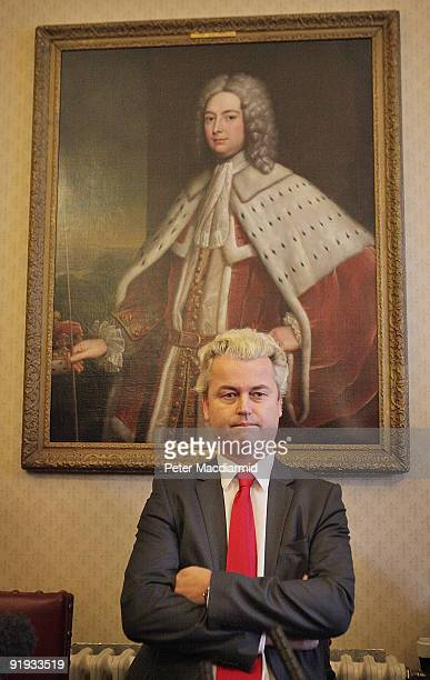 Rightwing Dutch MP Geert Wilders sits under a portrait of The Duke of Lancaster as he waits to speak to reporters on October 16 2009 in London Mr...