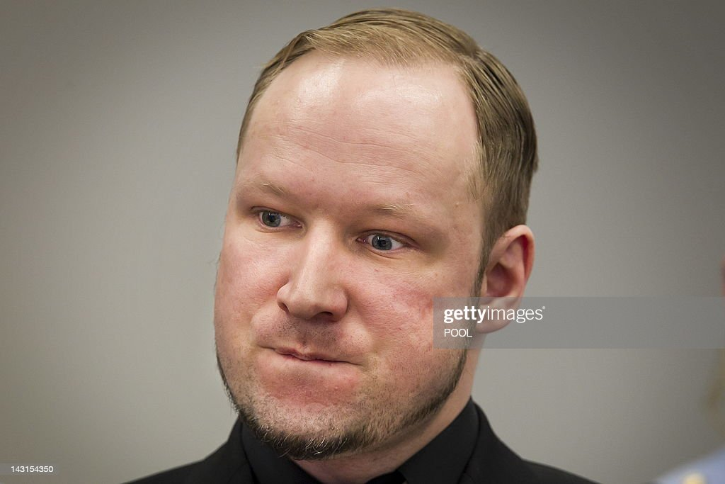 Right-wing extremist Anders Behring Breivik is pictured during his trial at the central court in Oslo on April 20, 2012. Breivik, who killed 77 people in Norway last July, took the stand again on the third day of his trial, a day after telling the court he would carry out his attacks again if he could. AFP PHOTO / Heiko Junge /NTB
