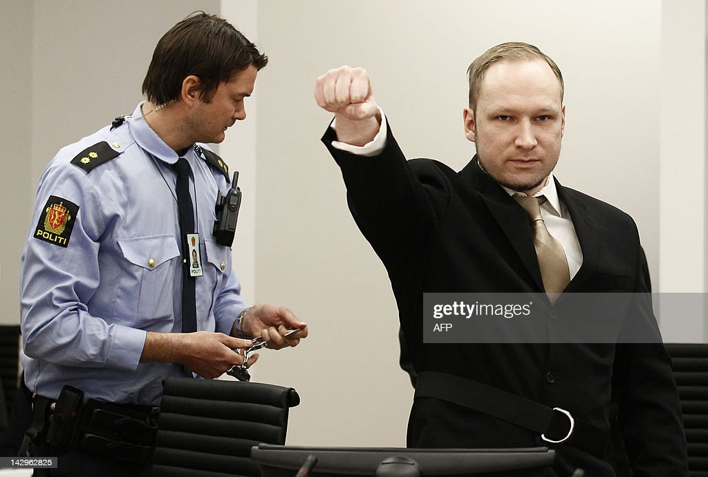 Rightwing extremist Anders Behring Breivik, who killed 77 people in twin attacks in Norway last year, makes a farright salute as he enters court on April 16, 2012, for his trial which begins today. Right-wing extremist Anders Behring Breivik made a farright salute as he entered the Oslo district courtroom Monday, where he goes on trial for killing 77 people in twin attacks last July. JUNGE