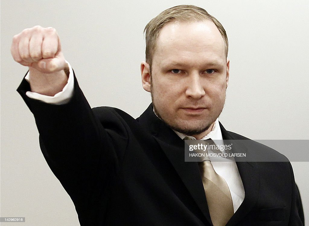 Rightwing extremist Anders Behring Breivik, who killed 77 people in twin attacks in Norway last year, makes a farright salute as he enters the Oslo district courtroom at the opening of his trial on April 16, 2012. Breivik told the Court that he did not recognise its legitimacy. Since Breivik has already confessed to the deadliest attacks in post-war Norway, the main line of questioning will revolve around whether he is criminally sane and accountable for his actions, which will determine if he is to be sentenced to prison or a closed psychiatric ward. AFP PHOTO / POOL / Hakon Mosvold Larsen
