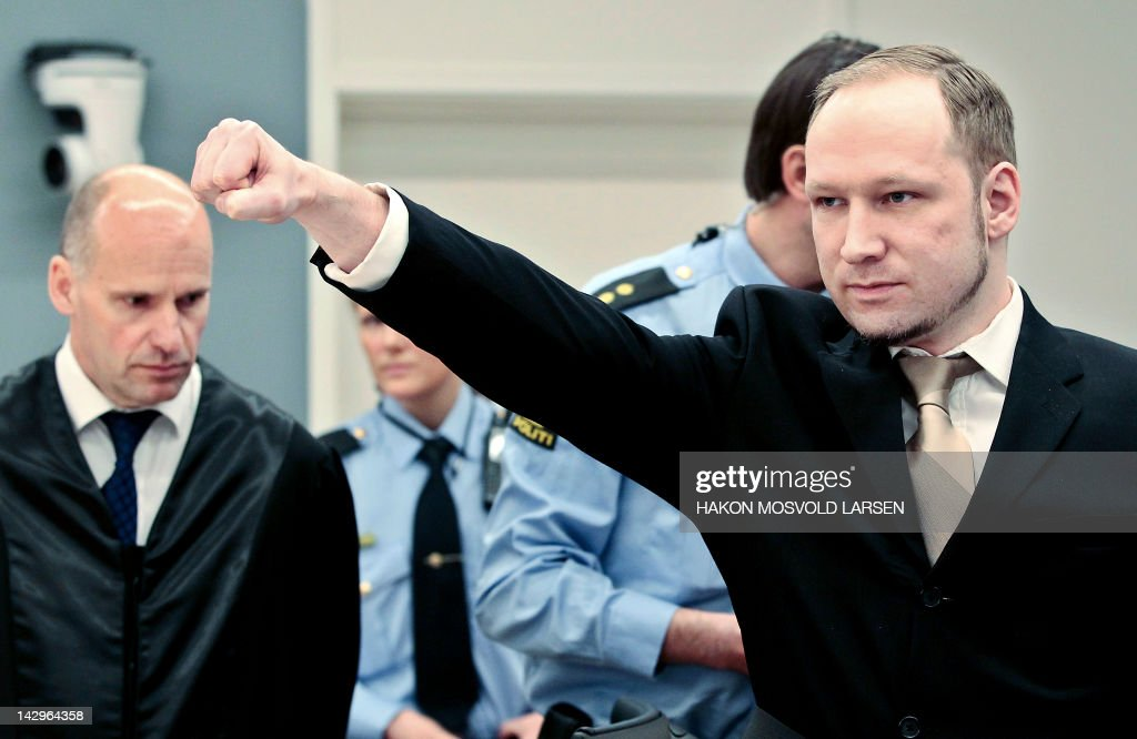 Rightwing extremist Anders Behring Breivik (R), who killed 77 people in twin attacks in Norway last year, makes a farright salute as he enters, with his lawyer Geir Lippestad (L), the Oslo district courtroom at the opening of his trial on April 16, 2012. Breivik told the Court that he did not recognise its legitimacy. Since Breivik has already confessed to the deadliest attacks in post-war Norway, the main line of questioning will revolve around whether he is criminally sane and accountable for his actions, which will determine if he is to be sentenced to prison or a closed psychiatric ward. AFP PHOTO / POOL / Hakon Mosvold Larsen