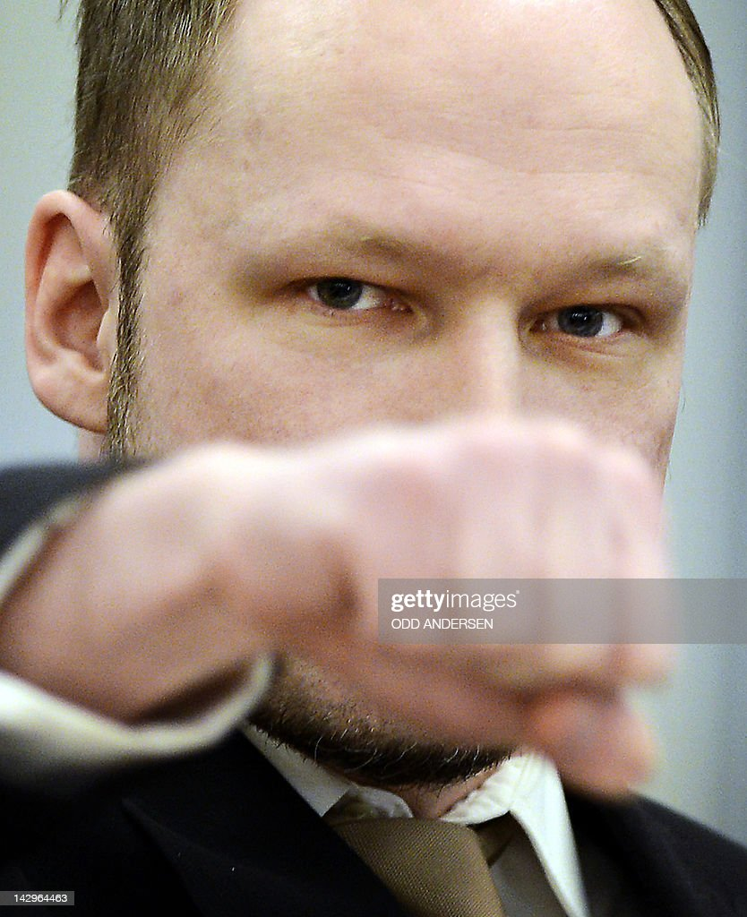 Rightwing extremist Anders Behring Breivik, who killed 77 people in twin attacks in Norway last year, makes a farright salute as he enters the Oslo district courtroom at the opening of his trial on April 16, 2012. Breivik told the Court that he did not recognise its legitimacy. Since Breivik has already confessed to the deadliest attacks in post-war Norway, the main line of questioning will revolve around whether he is criminally sane and accountable for his actions, which will determine if he is to be sentenced to prison or a closed psychiatric ward. AFP PHOTO / ODD ANDERSEN