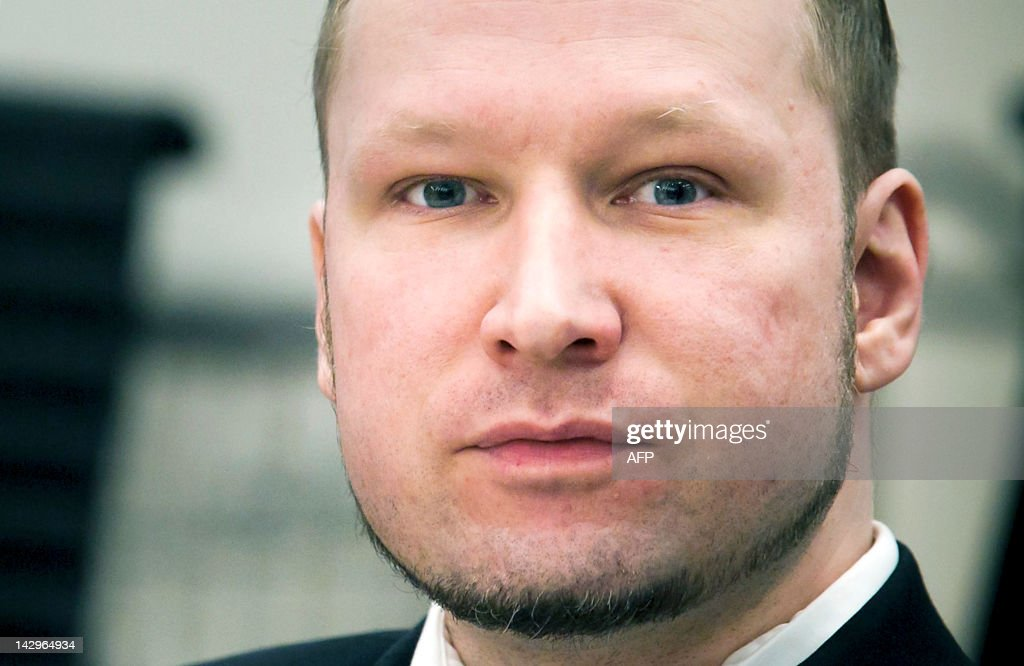 Rightwing extremist Anders Behring Breivik, who killed 77 people in twin attacks in Norway last year, looks on at the opening of his trial in Oslo district courtroom on April 16, 2012. Breivik told the Court that he did not recognise its legitimacy. Since Breivik has already confessed to the deadliest attacks in post-war Norway, the main line of questioning will revolve around whether he is criminally sane and accountable for his actions, which will determine if he is to be sentenced to prison or a closed psychiatric ward. AFP PHOTO / Heiko Junge