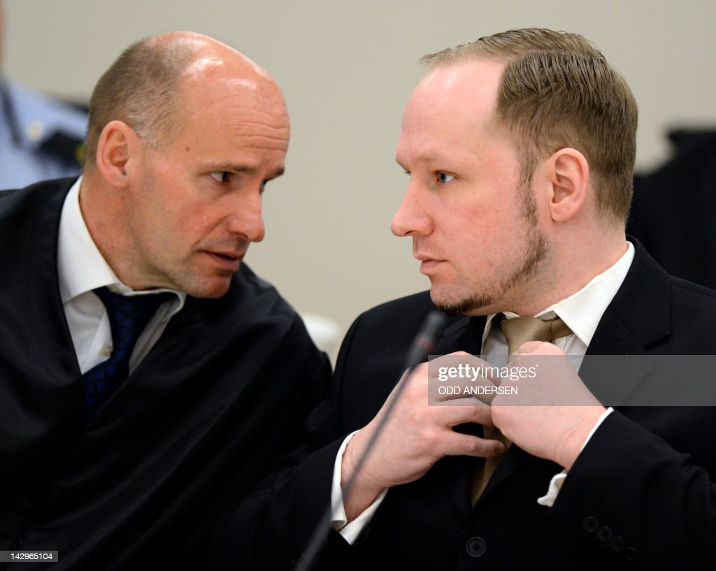 Rightwing extremist Anders Behring Breivik (R), who killed 77 people in twin attacks in Norway last year, speaks with his lawyer Geir Lippestad at the opening of his trial in Oslo district courtroom on April 16, 2012. Breivik told the Court that he did not recognise its legitimacy. Since Breivik has already confessed to the deadliest attacks in post-war Norway, the main line of questioning will revolve around whether he is criminally sane and accountable for his actions, which will determine if he is to be sentenced to prison or a closed psychiatric ward. AFP PHOTO / ODD ANDERSEN