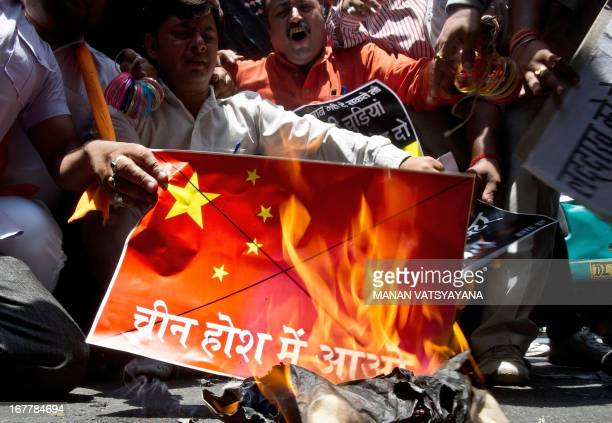 Rightwing Hindu activists burn a Chinese flag during a protest against the alleged incursion by Chinese troops inside Indiaoccupied territory in New...