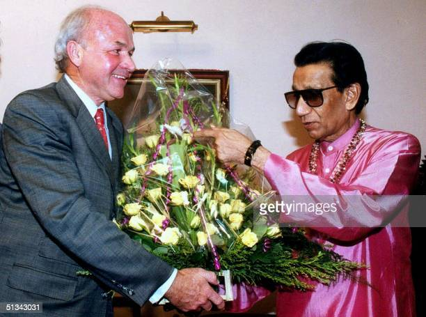 Rightwing Hindu Shiv Sena party chief Bal Thackeray accepts a bouquet from Enron Corp chairman Kenneth Lay during a call at his residence at Bandra...