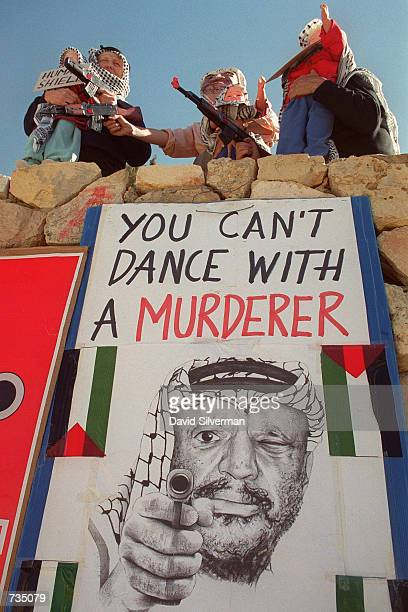 Rightwing Israeli extremists dressed as Arabs carry toy guns and dolls in protest November 12 2000 in Jerusalem Israel They claim that the...