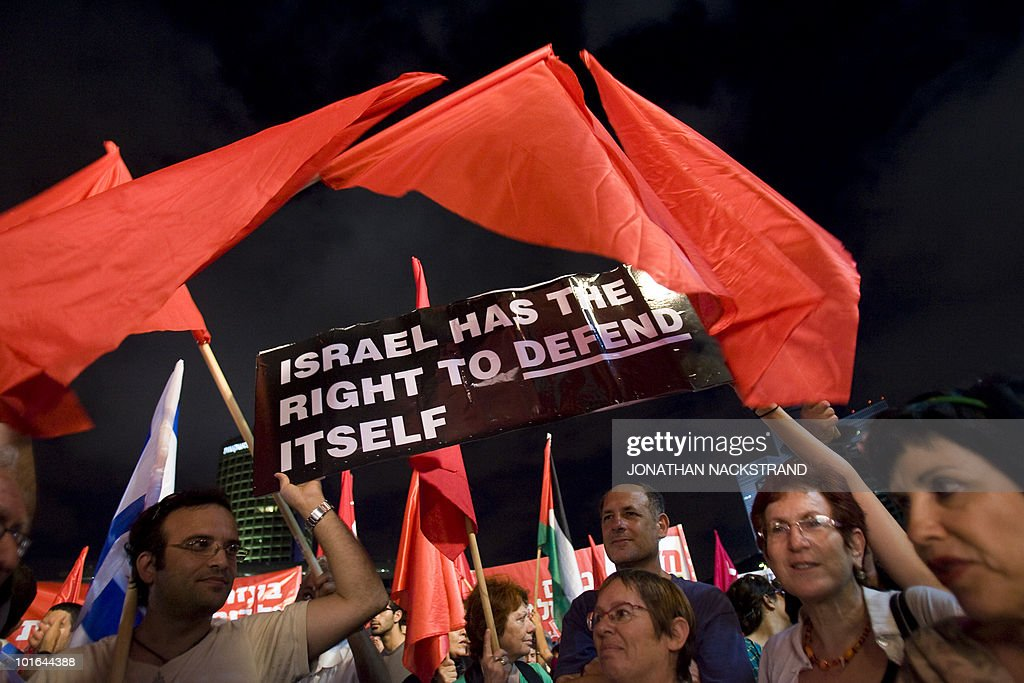 Right-wing Israelis holding up a banner with the slogan 'Israel has the right to defend itself' demonstrate against thousands of Arabs and left-wing Jewish peace activists who were protesting in Tel Aviv on June 5, 2010 against the occupation of Palestinian territories, marking the 43rd anniversary of their conquest in the 1967 Six-Day War.
