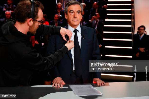 Rightwing Les Republicains party Francois Fillon waits before a debate organised by the French private TV channel TF1 between five candidates for the...
