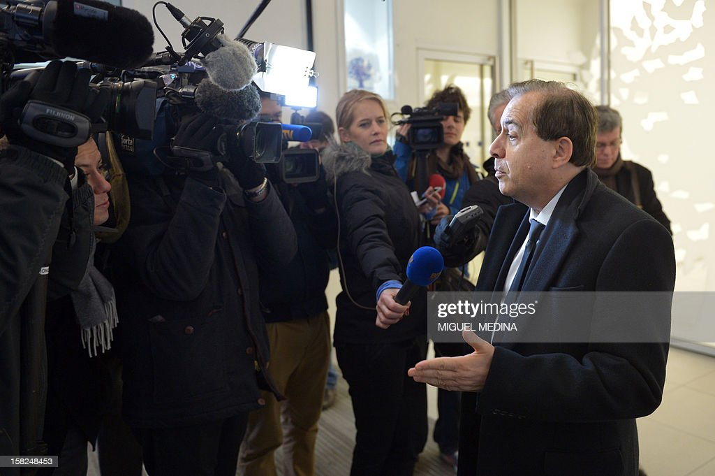 UMP right-wing party senator Roger Karoutchi speaks to the press before attending a press conference at the party's headquarters on December 12, 2012 in Paris. France's right-wing opposition UMP leader Jean-Francois Cope has refused calls for a new election and had proposed holding the referendum in December 2012 or January 2013, insisting he would remain party leader until a new vote. AFP PHOTO /MIGUEL MEDINA