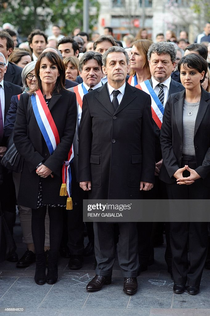 UMP righ-wing opposition party member of parliament and Toulouse deputy mayor, Laurence Arribage, current UMP President and former French President Nicolas Sarkozy, and French Education Minister <a gi-track='captionPersonalityLinkClicked' href=/galleries/search?phrase=Najat+Vallaud-Belkacem&family=editorial&specificpeople=4115928 ng-click='$event.stopPropagation()'>Najat Vallaud-Belkacem</a> attend a commemoration ceremony for the victims of French jihadist gunman Mohamed Merah, in Toulouse on March 19, 2015. Merah shot dead three soldiers in southern France in 2012 before killing three students and a teacher at a Jewish school more than a week later.