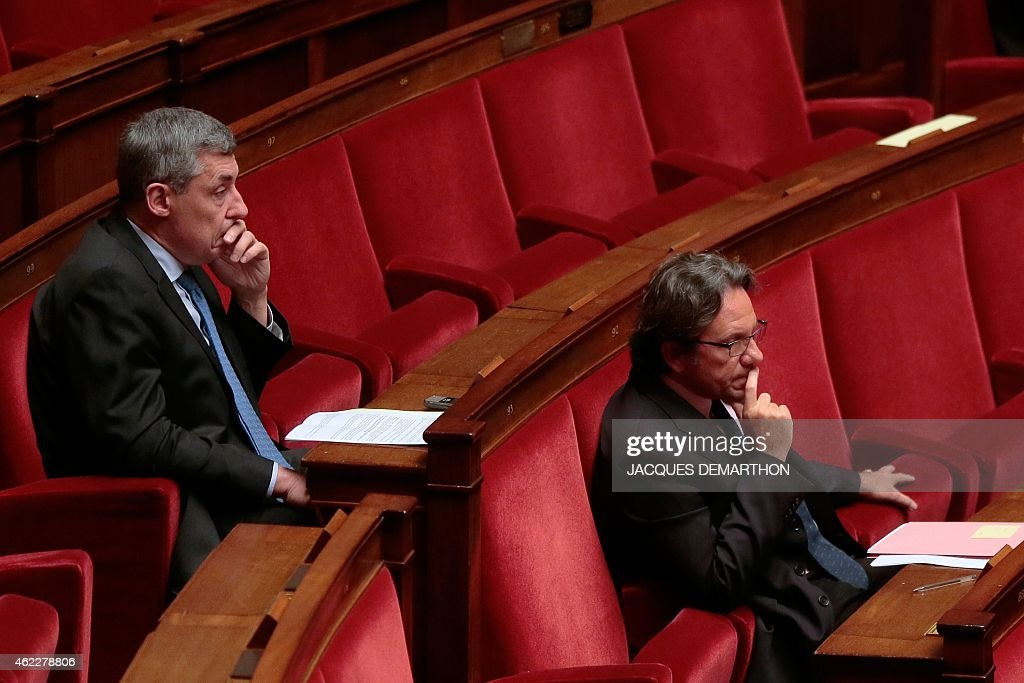 UMP righ-wing opposition party members of parliament <a gi-track='captionPersonalityLinkClicked' href=/galleries/search?phrase=Henri+Guaino&family=editorial&specificpeople=4206004 ng-click='$event.stopPropagation()'>Henri Guaino</a> (L) and <a gi-track='captionPersonalityLinkClicked' href=/galleries/search?phrase=Frederic+Lefebvre&family=editorial&specificpeople=4105627 ng-click='$event.stopPropagation()'>Frederic Lefebvre</a> attend the first day of a debate on a draft bill, know as the 'Macron Bill', on January 26, 2015 at the French National Assembly in Paris. The reforms, which includes the extension of Sunday shop opening, have proved highly controversial within the country and even within French Economy minister Emmanuel Macron's own ruling Socialist Party.