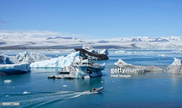Rigid inflatable boat and icebergs in glacier lagoon at Jokulsarlon, Iceland