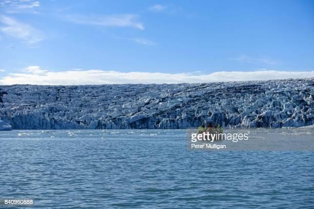 Rigid inflatable boat in front of the Breiðamerkurjökull Glacier; Jökulsárlón, Iceland.