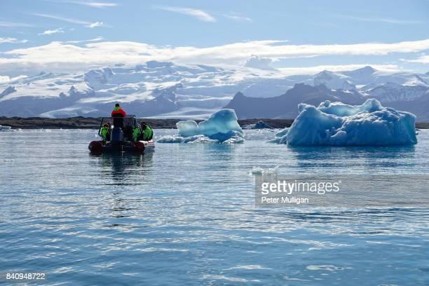 Rigid inflatable boat near icebergs in the glacier lagoon of Jökulsárlón, Iceland