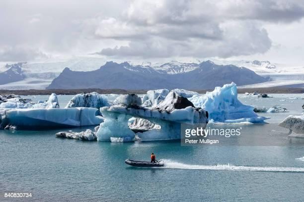 Rigid inflatable boat speeding across glacier lagoon, Jökulsárlón, Iceland